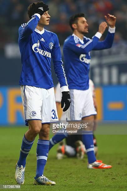 Julian Draxler and Ciprian Marica of Schalke look dejected during the Bundesliga match between FC Schalke 04 and Borussia Moenchengladbach at...