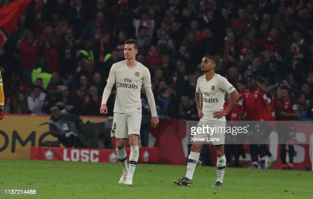 Julian Draxler and Colin Dagba of Paris SaintGermain are disapointed during the Ligue 1 match between Lille OSC and Paris SaintGermain at Stade...