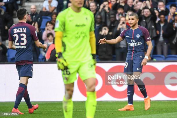 Julian Draxler and Kylian Mbappe of PSG celebrates a goal during the Ligue 1 match between Paris Saint Germain and Metz at Parc des Princes on March...