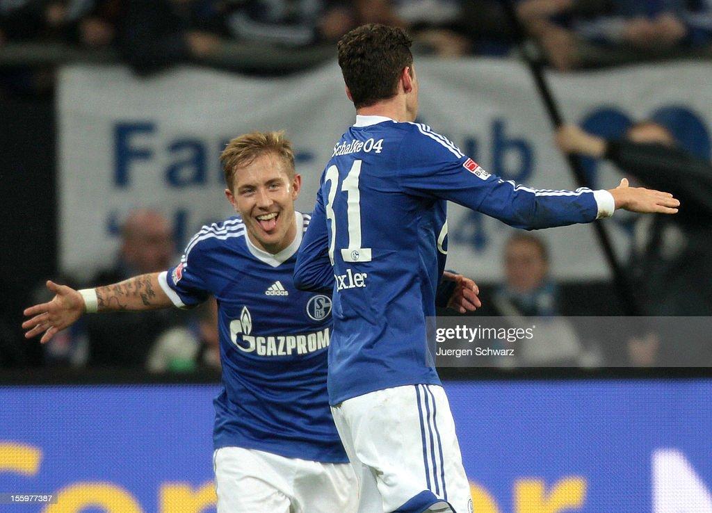 Julian Draxler (R) and Lewis Holtby of Schalke celebrate after scoring at the Bundesliga match between FC Schalke 04 and Werder Bremen at Veltins-Arena on November 10, 2012 in Gelsenkirchen, Germany.