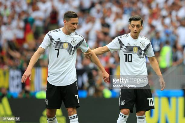 Julian Draxler and Mesut Ozil of Germany are seen during the 2018 FIFA World Cup Russia Group F match between Germany and Mexico at the Luzhniki...