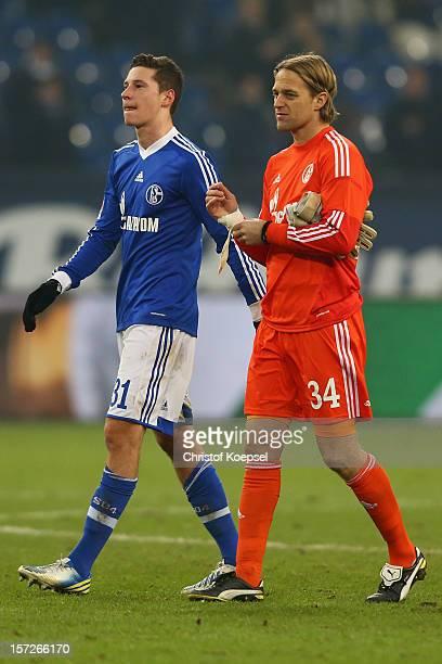 Julian Draxler and Timo Hildebrand of Schalke look dejected after the Bundesliga match between FC Schalke 04 and Borussia Moenchengladbach at...