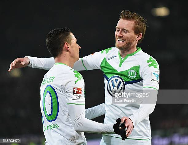 Julian Draxler celebrates scoring the fourth goal with André Schürrle of Wolfsburg during the Bundesliga match between Hannover 96 and VfL Wolfsburg...