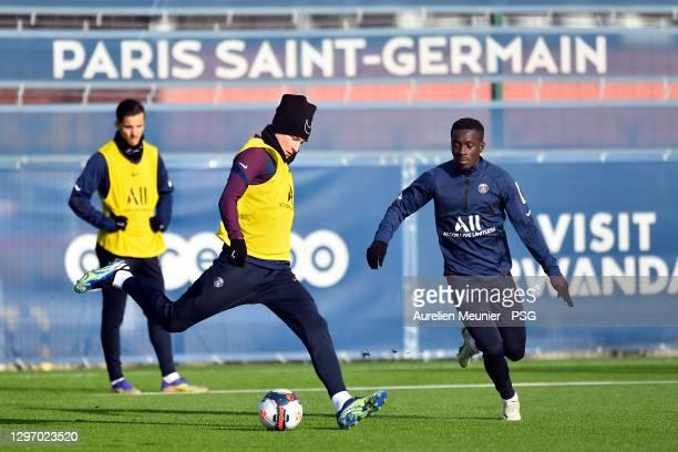 Julian Draxler kicks the ball during a Paris Saint-Germain training session at Ooredoo Center on January 18, 2021 in Paris, France.