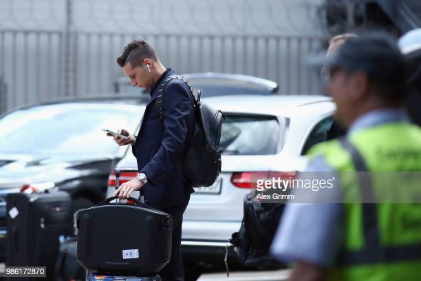 Julian Draxler looks on during the return of the German national football team from the FIFA World Cup Russia 2018 at Frankfurt International Airport...