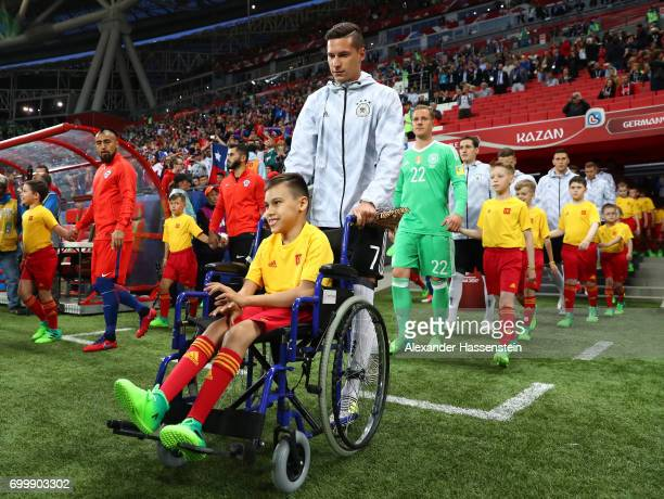 Julian Draxler of Gerany leads his team out prior to the FIFA Confederations Cup Russia 2017 Group B match between Germany and Chile at Kazan Arena...