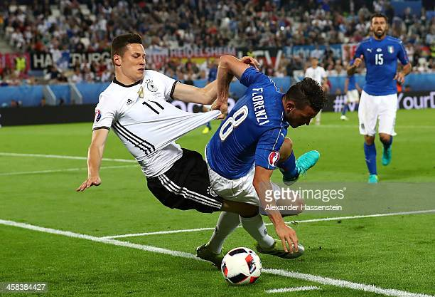 Julian Draxler of Germany and Alessandro Florenzi of Italy compete for the ball during the UEFA EURO 2016 quarter final match between Germany and...
