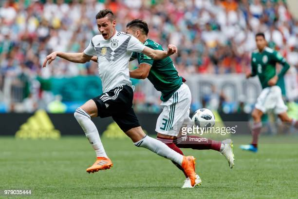 Julian Draxler of Germany and Carlos Salcedo of Mexico battle for the ball during the 2018 FIFA World Cup Russia group F match between Germany and...