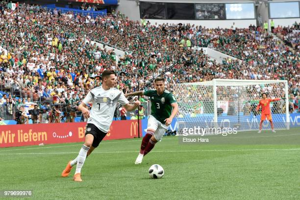 Julian Draxler of Germany and Carlos Salcedo of Mexico compete for the ball during the 2018 FIFA World Cup Russia group F match between Germany and...