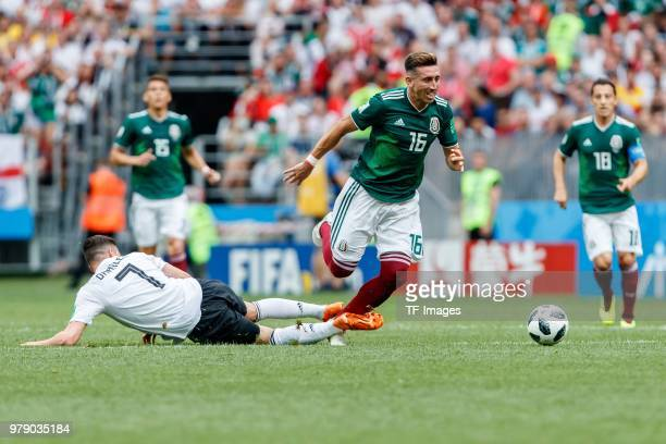Julian Draxler of Germany and Hector Herrera of Mexico battle for the ball during the 2018 FIFA World Cup Russia group F match between Germany and...