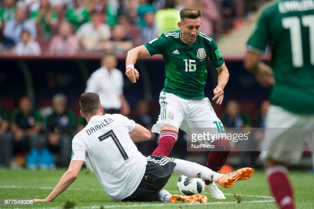 Julian Draxler of Germany and Hector Herrera of Mexico during the 2018 FIFA World Cup Russia Group F match between Germany and Mexico at Luzhniki...