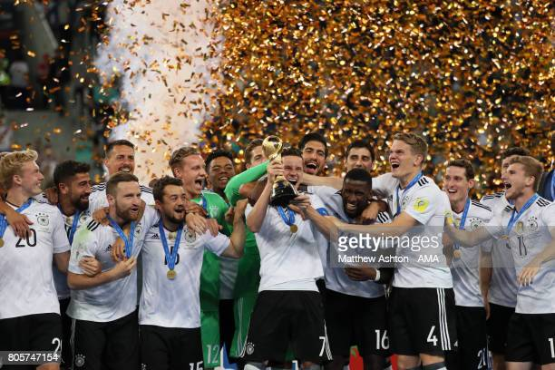 Julian Draxler of Germany and his teammates celebrate with the trophy at the end of the FIFA Confederations Cup Russia 2017 Final match between Chile...