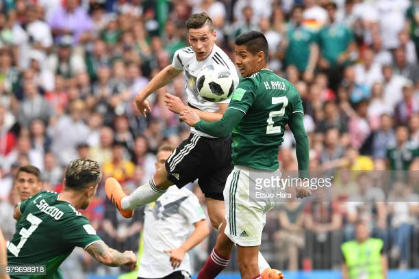 Julian Draxler of Germany and Hugo Ayala of Mexico compete for the ball during the 2018 FIFA World Cup Russia group F match between Germany and...