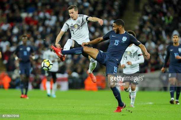 Julian Draxler of Germany and Joe Gomez of England battle for the ball during the international friendly match between England and Germany at Wembley...