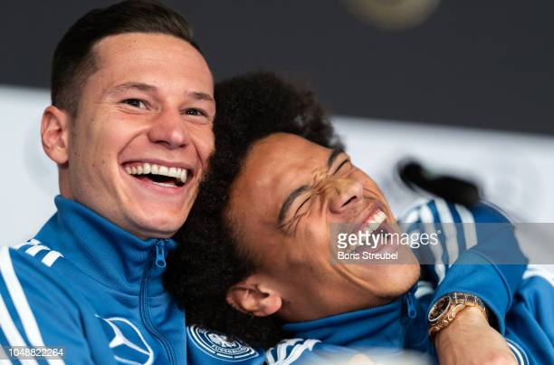 Julian Draxler of Germany and Leroy Sane of Germany laugh during a press conference of the German national team at Mercedes-Benz am Salzufer on...