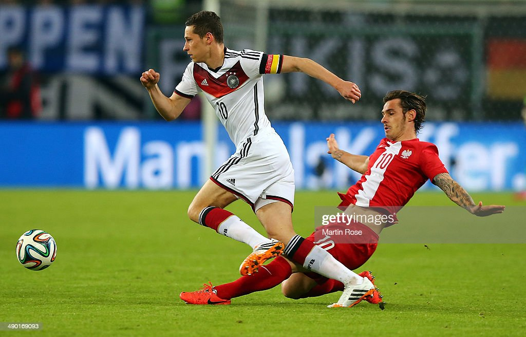Julian Draxler (L) of Germany and Ludovic Obraniak (R) of Poland battle for the ball during the International Friendly Match between Germany and Poland at Imtech Arena on May 13, 2014 in Hamburg, Germany.