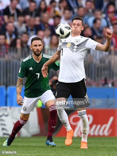 Julian Draxler of Germany and Miguel Layun of Mexico compete for the ball during the 2018 FIFA World Cup Russia group F match between Germany and...