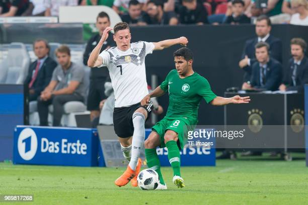Julian Draxler of Germany and Yahia AlShehri of Saudi Arabia battle for the ball during the international friendly match between Germany and Saudi...
