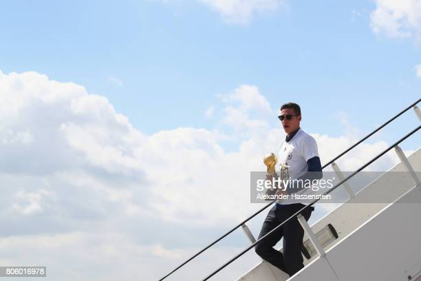 Julian Draxler of Germany arrives with his team at Frankfurt am Main Interantional Airpoport on July 3 2017 in Frankfurt am Main Germany
