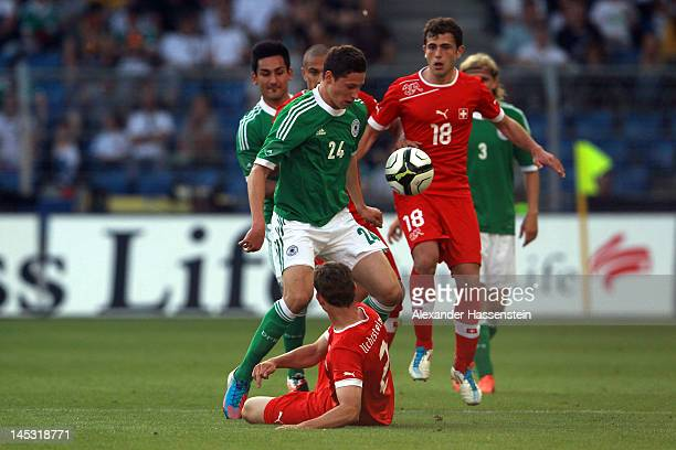 Julian Draxler of Germany battles for the ball with Admir Mehemedi of Switzerland and his team mate Stephan Lichtsteiner during the international...