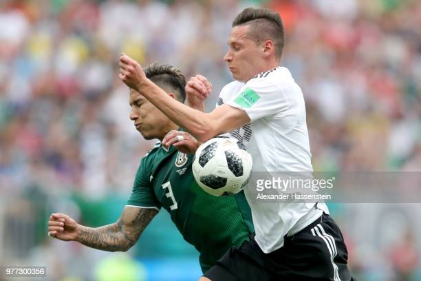 Julian Draxler of Germany battles for the ball with Carlos Salcedo of Mexico during the 2018 FIFA World Cup Russia group F match between Germany and...