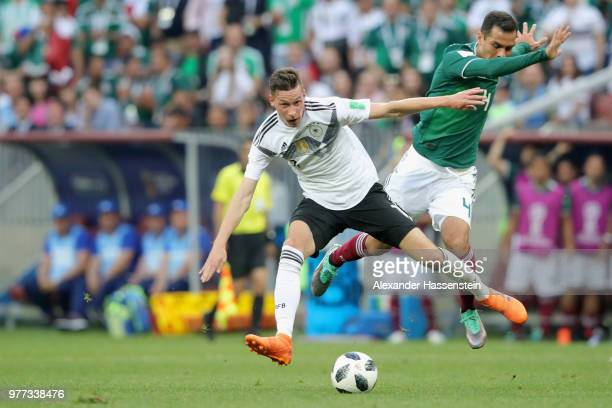 Julian Draxler of Germany battles for the ball with Rafael Marquez of Mexico during the 2018 FIFA World Cup Russia group F match between Germany and...