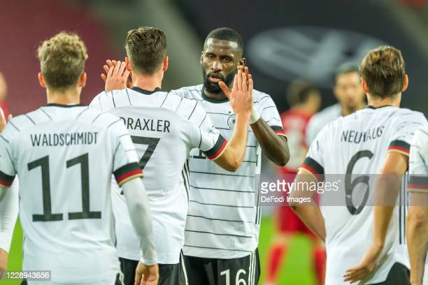 Julian Draxler of Germany celebrates after scoring his team's first goal with teammates during the international friendly match between Germany and...