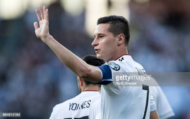 Julian Draxler of Germany celebrates after scoring his team's first goal during the FIFA 2018 World Cup Qualifier between Germany and San Marino at...