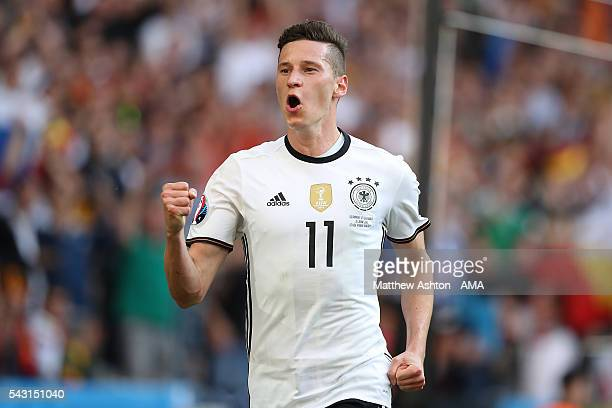 Julian Draxler of Germany celebrates scoring a goal to make the score 30 during the UEFA Euro 2016 Round of 16 match between Germany and Slovakia at...