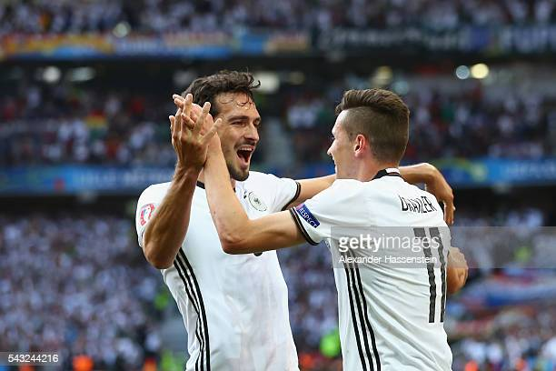 Julian Draxler of Germany celebrates scoring his team's third goal with his team mate Mats Hummels during the UEFA EURO 2016 round of 16 match...