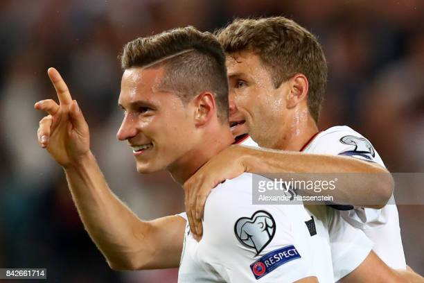 Julian Draxler of Germany celebrates scoring the 2nd team goal with his team mate Thomas Mueller during the FIFA 2018 World Cup Qualifier between...
