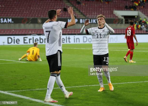 Julian Draxler of Germany celebrates with Luca Waldschmidt of Germany after scoring his team's first goal during the international friendly match...