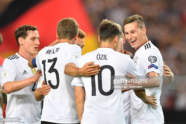 Julian Draxler of Germany celebrates with Mesut Oezil of Germany and Thomas Mueller of Germany after he scored to make it 20 during the FIFA 2018...
