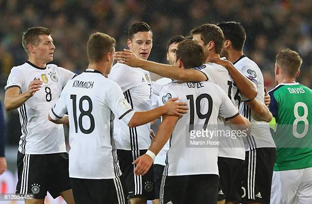 Julian Draxler of Germany celebrates with team mates after scoring his sides first goal during the FIFA 2018 World Cup Qualifier between Germany and...