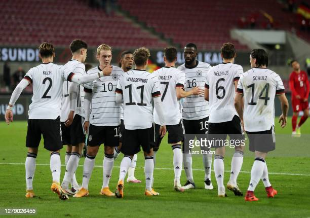 Julian Draxler of Germany celebrates with teammates after scoring his team's first goal during the international friendly match between Germany and...