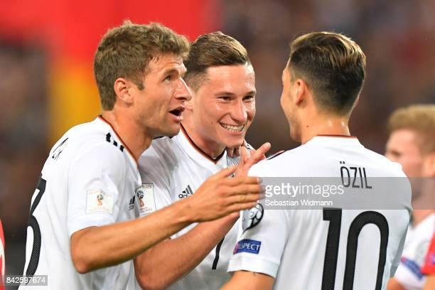 Julian Draxler of Germany celebrates with Thomas Mueller of Germany and Mesut Oezil of Germany after he scored to make it 20 during the FIFA 2018...