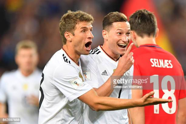 Julian Draxler of Germany celebrates with Thomas Muellerof Germany after he scored to make it 20 during the FIFA 2018 World Cup Qualifier between...