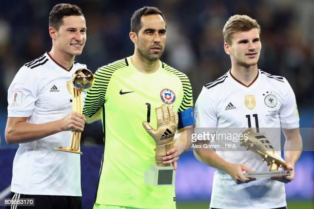 Julian Draxler of Germany Claudio Bravo of Chile and Timo Werner of Germany pose after the FIFA Confederations Cup Russia 2017 final between Chile...