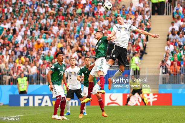 Julian Draxler of Germany competes with Hector Moreno of Mexico during the 2018 FIFA World Cup Russia group F match between Germany and Mexico at...