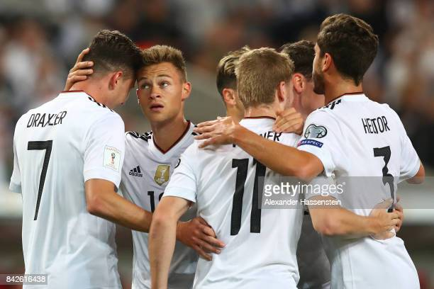 Julian Draxler of Germany is being celebrated by Joshua Kimmich of Germany and other players after the scored to make it 20 during the FIFA 2018...