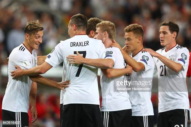 Julian Draxler of Germany is being celebrated by Mesut Oezil of Germany and other players after the scored to make it 20 during the FIFA 2018 World...
