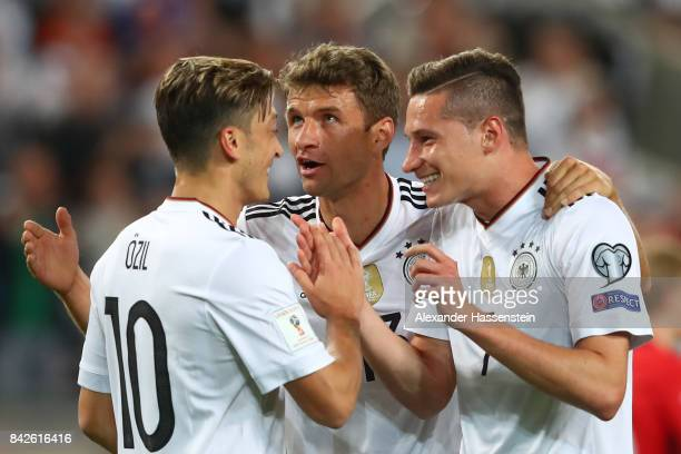 Julian Draxler of Germany is being celebrated by Mesut Oezil of Germany and Thomas Mueller of Germany after the scored to make it 2:0 during the FIFA...
