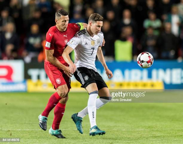 Julian Draxler of Germany is challenged by Marek Suchy of Czech Republic during the FIFA 2018 World Cup Qualifier between Czech Republic and Germany...