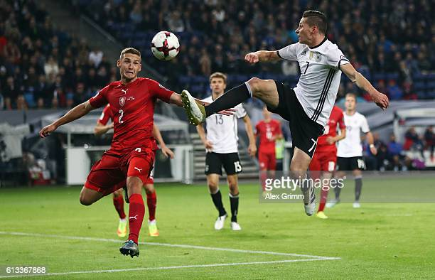 Julian Draxler of Germany is challenged by Pavel Kaderabek of Czech Republic during the FIFA World Cup 2018 qualifying match between Germany and...