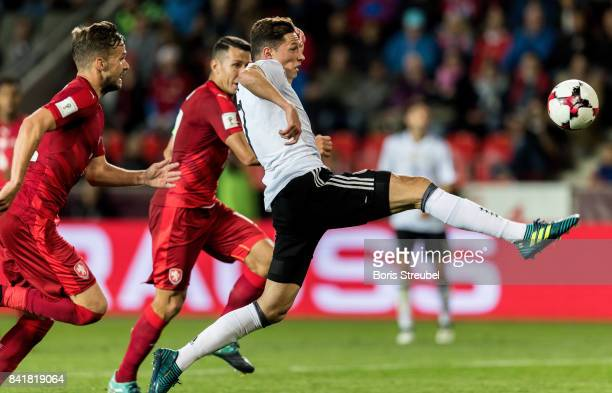 Julian Draxler of Germany is challenged by players of Czech Republic during the FIFA 2018 World Cup Qualifier between Czech Republic and Germany at...
