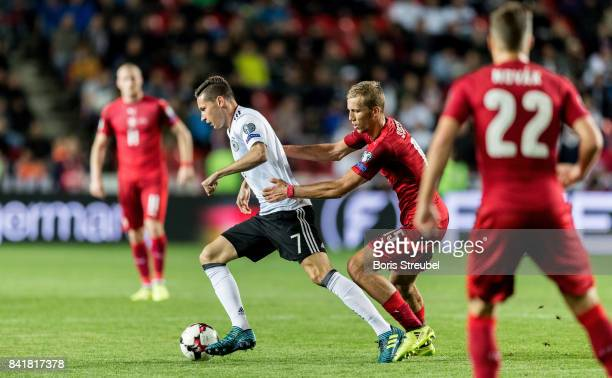Julian Draxler of Germany is challenged by Tomas Soucek of Czech Republic during the FIFA 2018 World Cup Qualifier between Czech Republic and Germany...