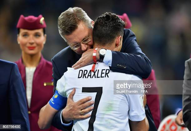 Julian Draxler of Germany is congratulated by DFB President Reinhard Grindel at the award ceremony after the FIFA Confederations Cup Russia 2017...
