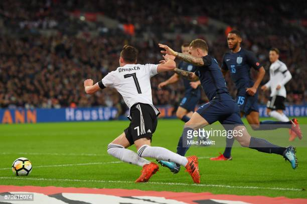 Julian Draxler of Germany is fouled by Kieran Trippier of England during the International friendly match between England and Germany at Wembley...