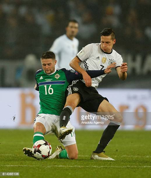 Julian Draxler of Germany is in action with Oliver Norwood of Northern Ireland during the FIFA 2018 World Cup Qualifier between Germany and Northern...