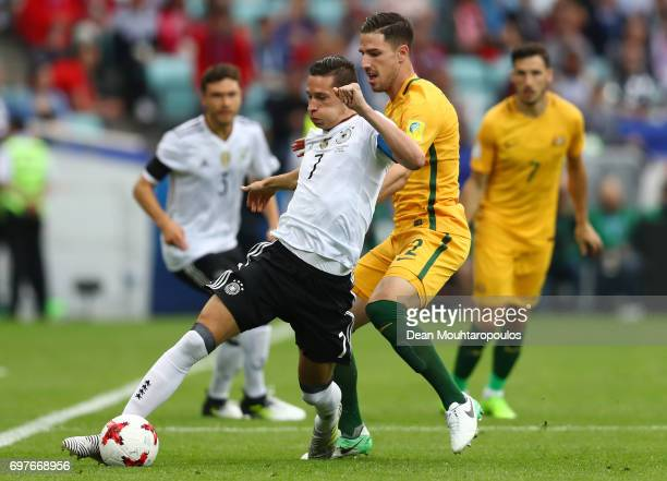 Julian Draxler of Germany is put under pressure from Milos Degenek of Australia during the FIFA Confederations Cup Russia 2017 Group B match between...